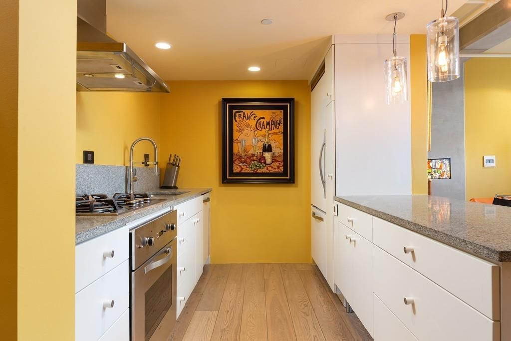 A kitchen with two counters and a narrow passageway between them.