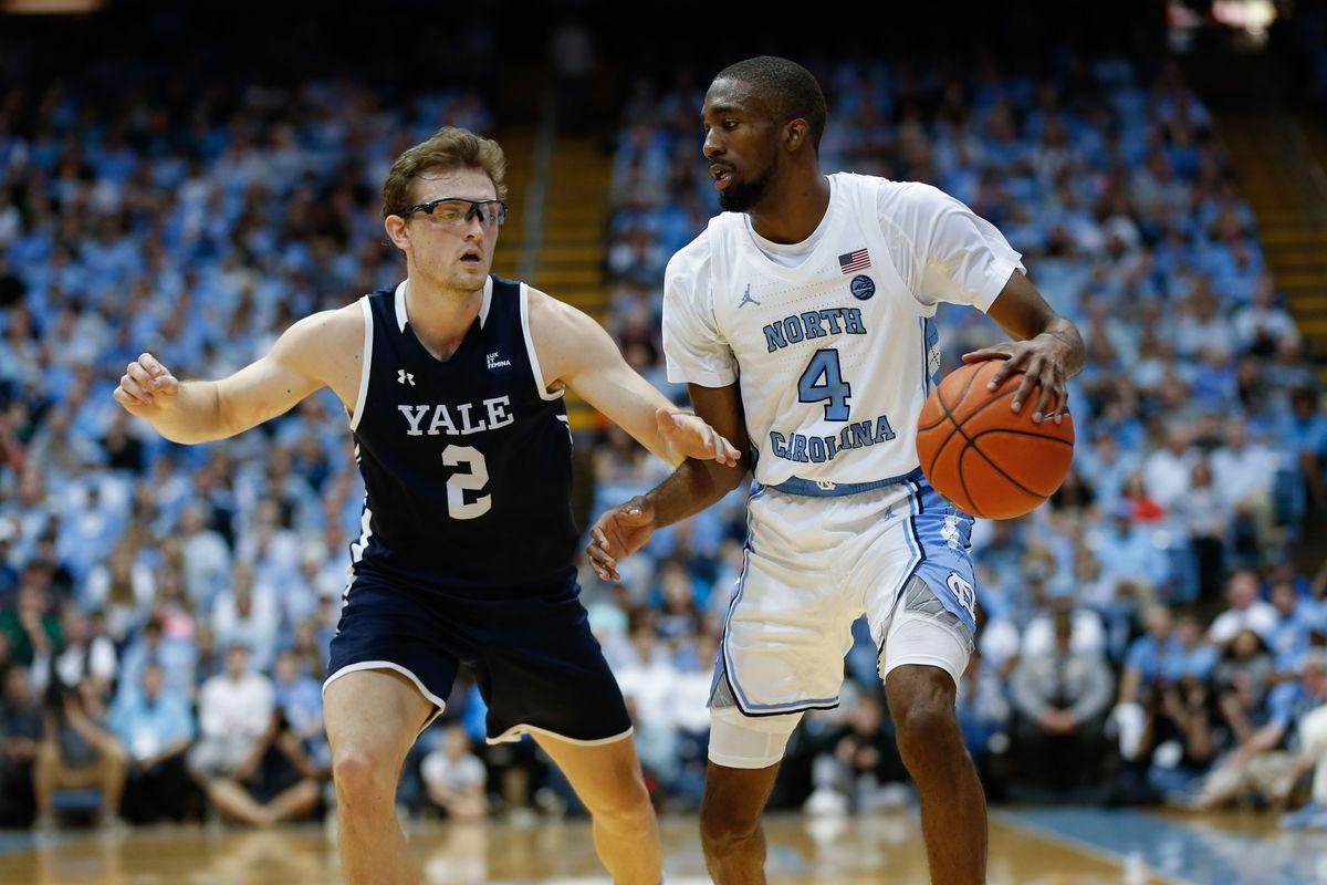 North Carolina Tar Heels guard Brandon Robinson against Yale Bulldogs guard Eric Monroe in the second half at Dean E. Smith Center.