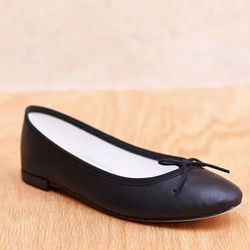 """Repetto <a href=""""http://www.mohawkgeneralstore.net/products/119853124"""">ballerina flat</a>: """"Nothing goes with pretty little frocks quite like black ballet flats. My tip: Get some rubber on the soles of these—you'll slip and slide in the supermarket"""