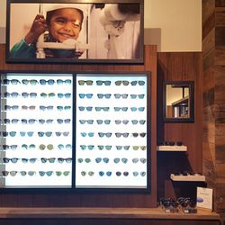 The eyewear department is located at the front of the shop.
