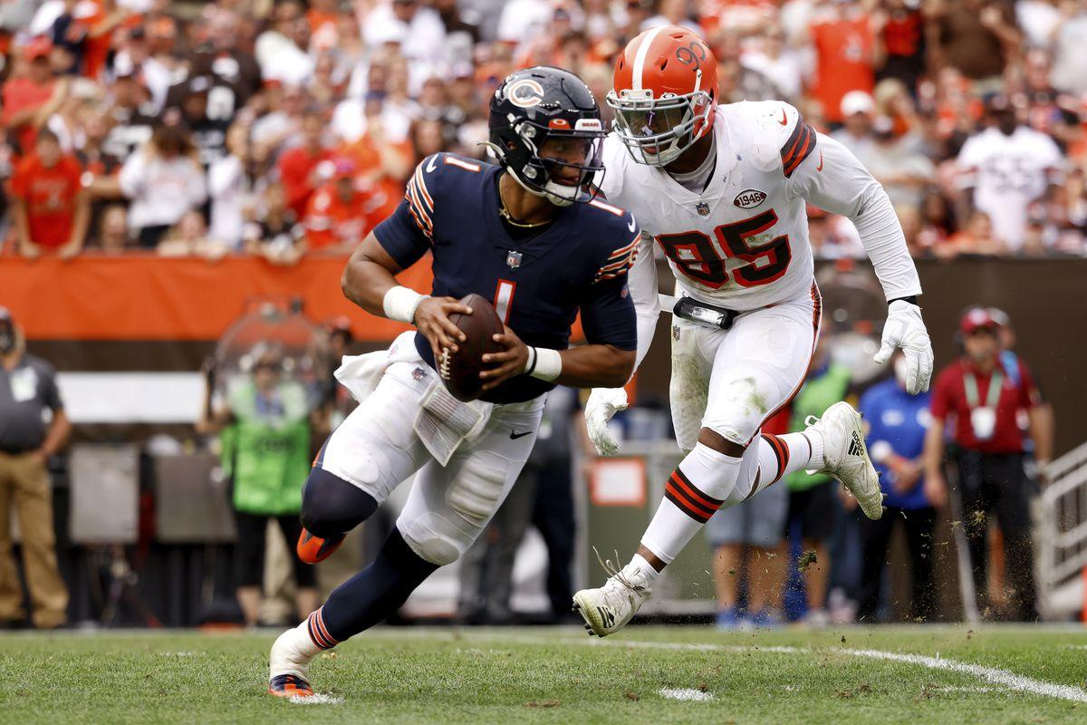 Bears quarterback Justin Fields runs away from Browns defensive end Myles Garrett (95) on Sunday. Garrett had 4.5 sacks in the Browns' 26-6 victory at FirstEnergy Stadium in Cleveland.