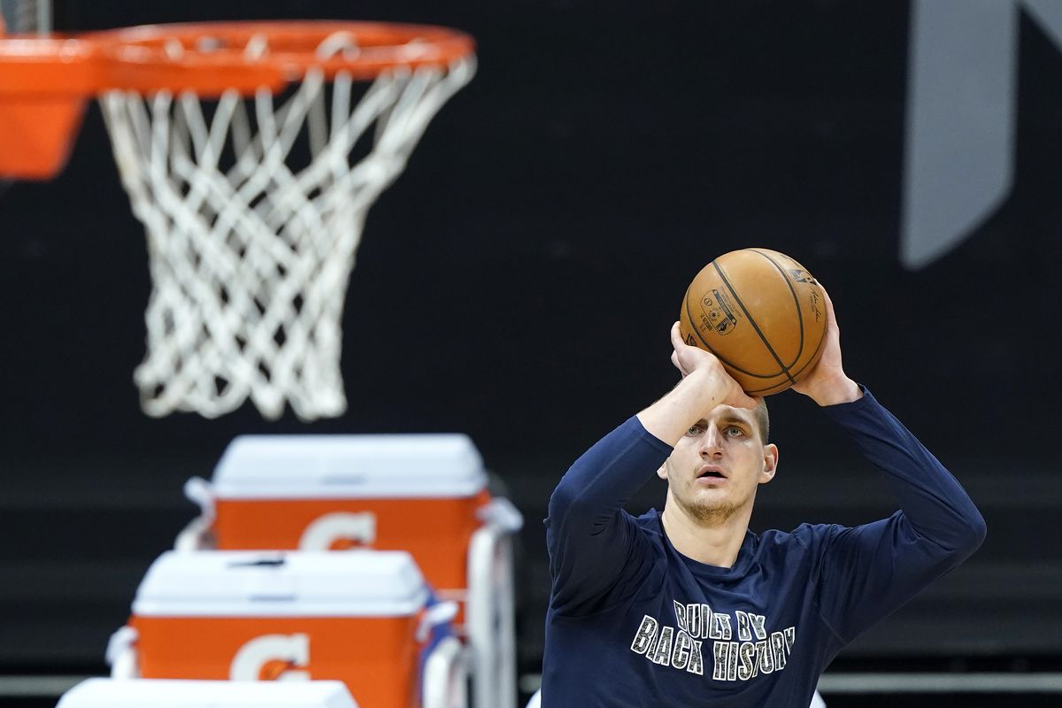 Nikola Jokic of the Denver Nuggets warms up prior to the start of an NBA basketball game against the Sacramento Kings at Golden 1 Center on February 06, 2021 in Sacramento, California.