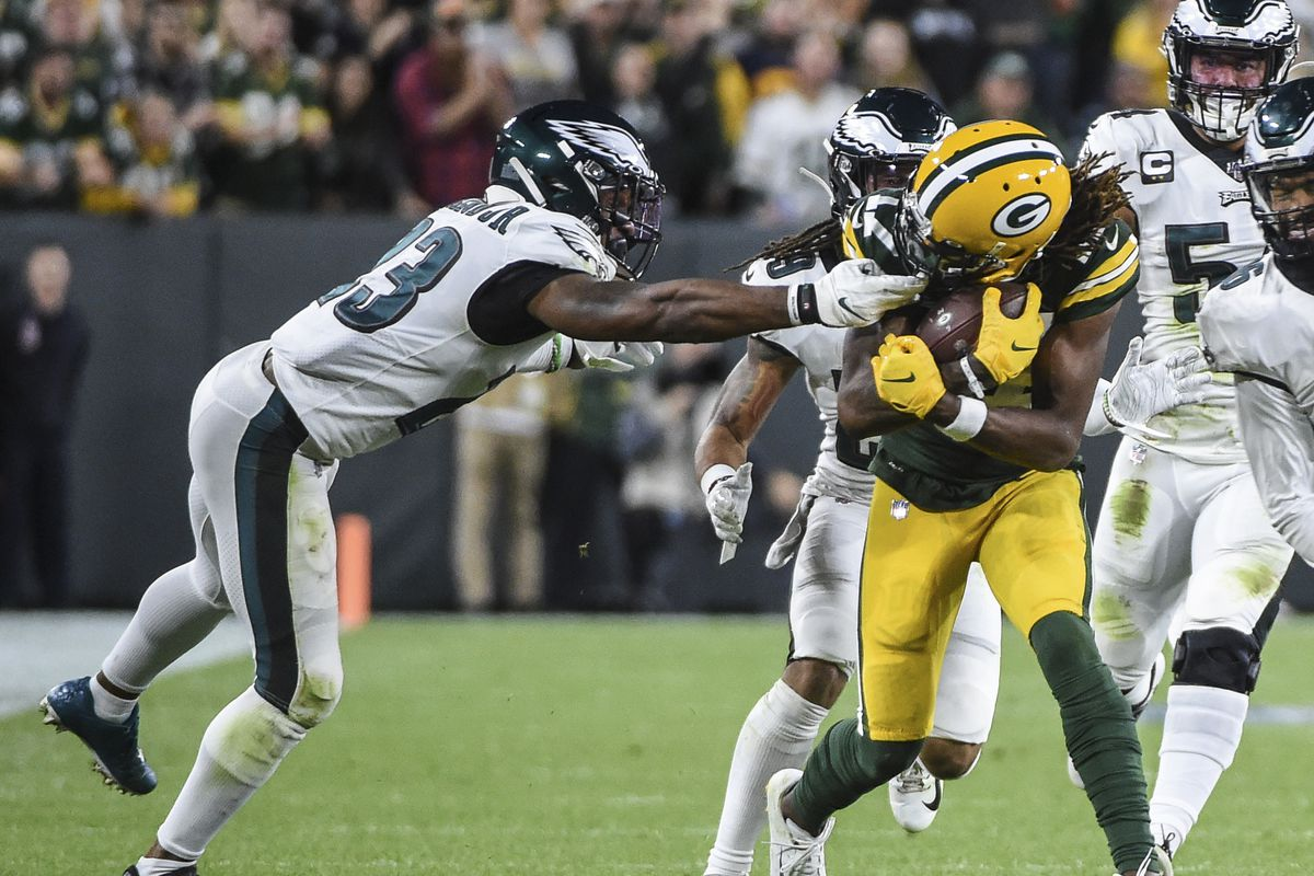 Philadelphia Eagles free safety Rodney McLeod grabs Green Bay Packers wide receiver Davante Adams by the face mask after a catch in the second quarter at Lambeau Field.