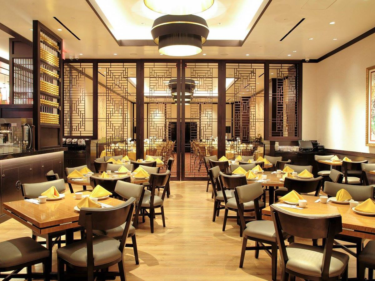 The interior of a Chinese restaurant in cream and black