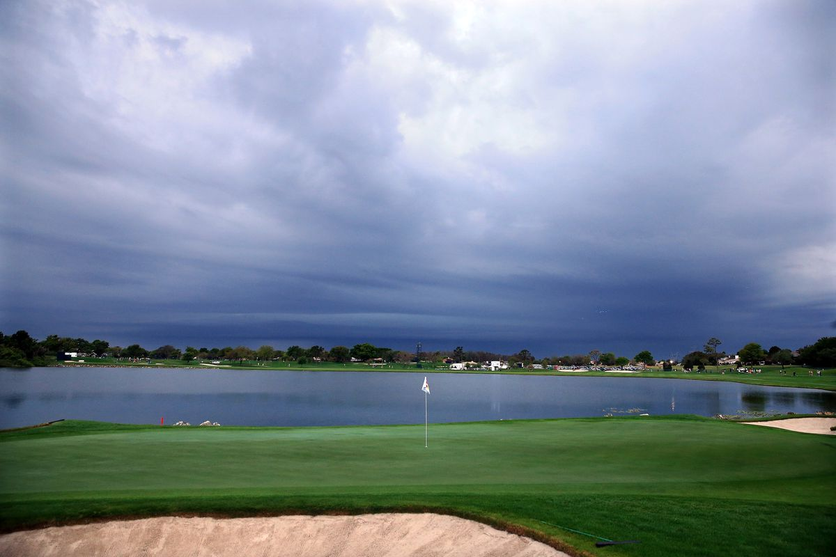 2013 Arnold Palmer Invitational postponed with Tiger Woods leading on Sunday
