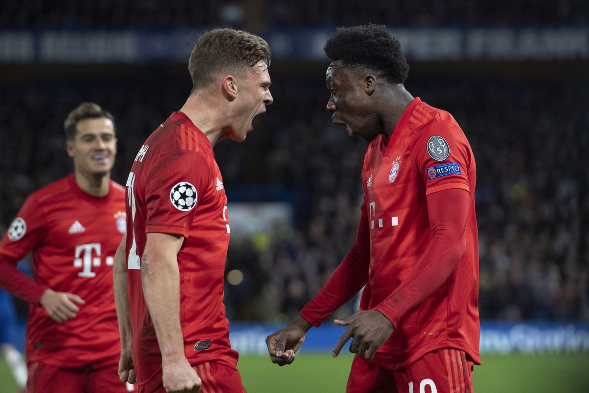 Alphonso Davies and Joshua Kimmich of FC Bayern Munchen celebrate the third goal during the UEFA Champions League round of 16 first leg match between Chelsea FC and FC Bayern Muenchen at Stamford Bridge on February 25, 2020 in London, United Kingdom.