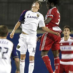 Real Salt Lake's Emiliano Bonfigli (12) and FC Dallas' Ugo Ihemelu (3) jump for the ball during the second half of an MLS soccer game on Wednesday, April 25, 2012, in Frisco, Texas. The teams played to a 1-1 tie.  (AP Photo/LM Otero)