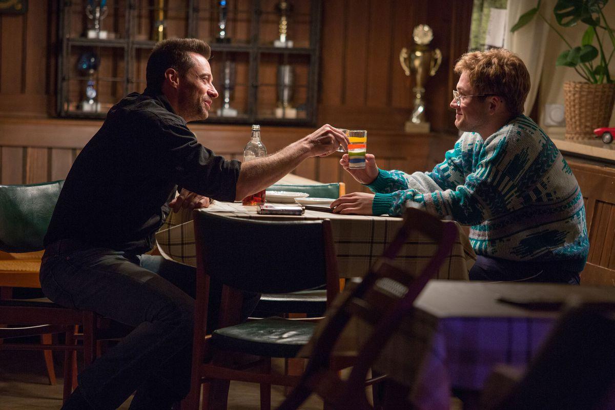 Hugh Jackman and Taron Egerton in Eddie the Eagle.