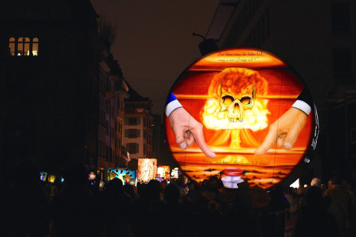 A painting on a float representing Donald Trump and Kim Jong Un pushing the nuclear red button during a carnival in Switzerland.