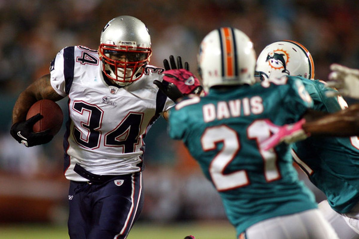 MIAMI - OCTOBER 04:  Running back Sammie Morris #34 of the New England Patriots runs  against the Miami Dolphins at Sun Life Stadium on October 4 2010 in Miami Florida.  (Photo by Marc Serota/Getty Images)
