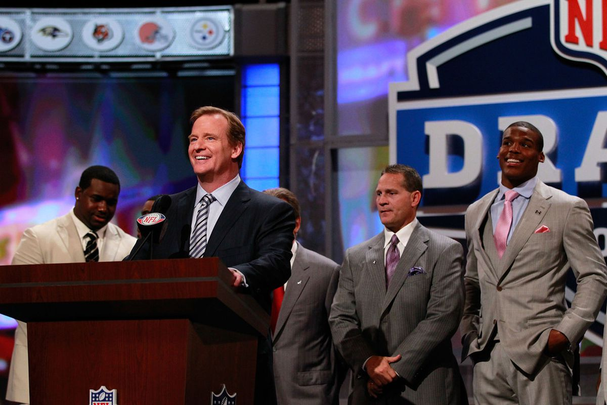 NEW YORK, NY - APRIL 28:  NFL Commissioner Roger Goodell speaks at the podium as draft prospect Cam Newton looks on (R) during the 2011 NFL Draft at Radio City Music Hall on April 28, 2011 in New York City.  (Photo by Chris Trotman/Getty Images)