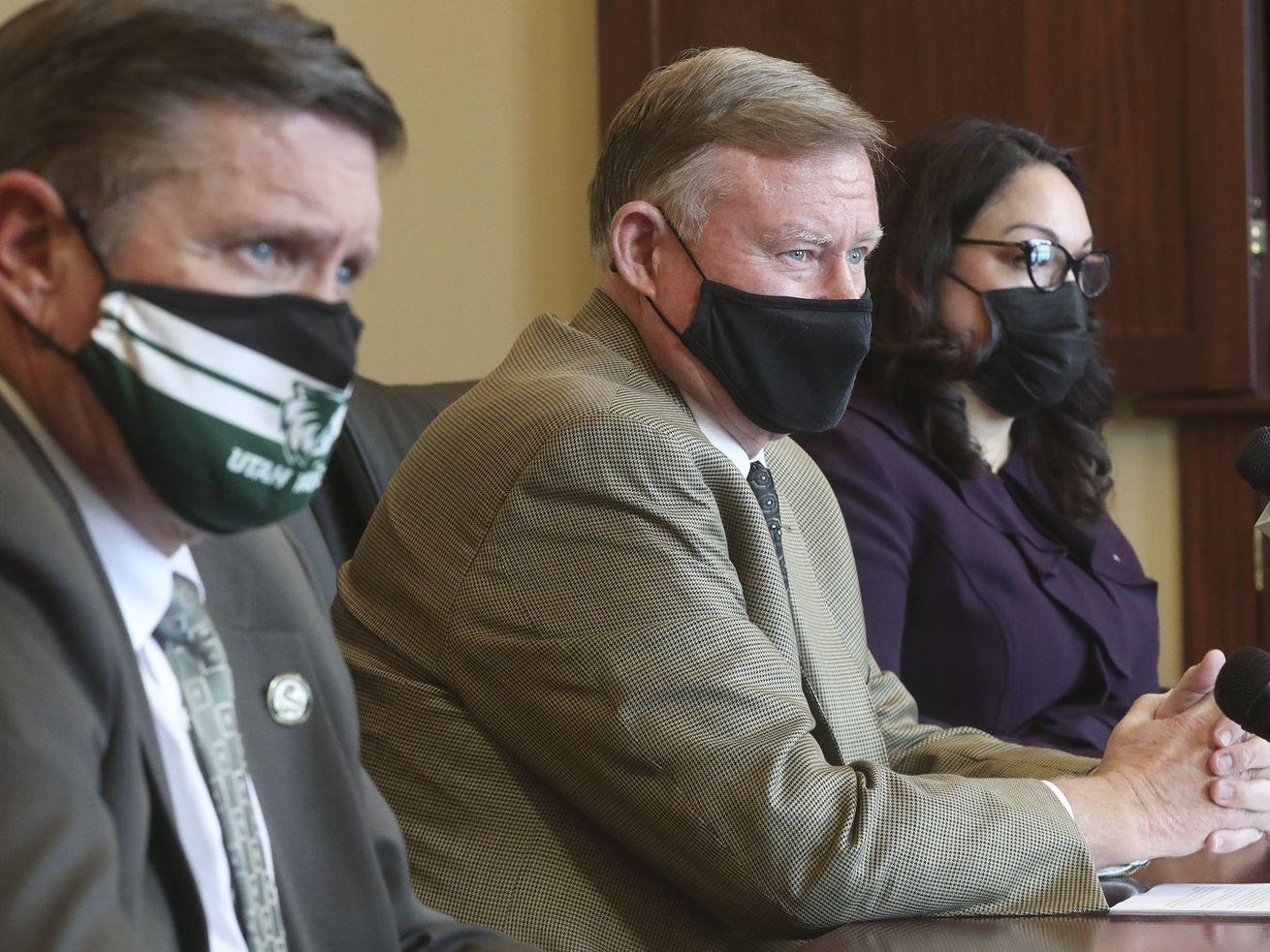 Rep. Val Peterson, R-Orem, left, Senate Majority Leader Evan Vickers, R-Cedar City, and Sen. Luz Escamilla, D-Salt Lake City, discuss SB195 in the Senate Rules Room at the Capitol in Salt Lake City on Wednesday, Feb. 17, 2021.