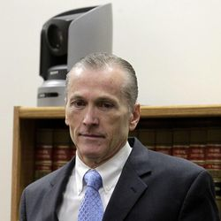 Former Pleasant Grove physician Martin MacNeill arrives in Provo's 4th District Court on Friday, Nov. 8, 2013. MacNeill is charged with murder in the 2007 death of his wife, Michele MacNeill.