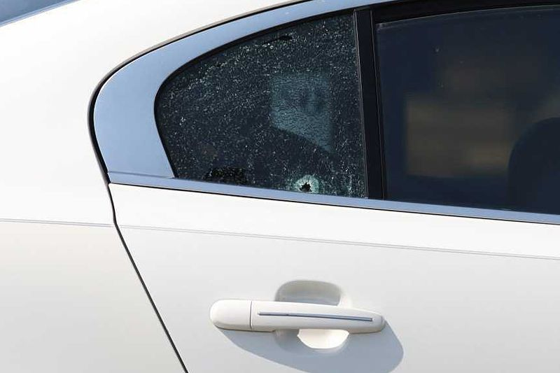 A bullet hole could be seen in the rear passenger window of a car in which a child was shot April 6, 2021, near at Monroe and Lake Shore drives near Grant Park.