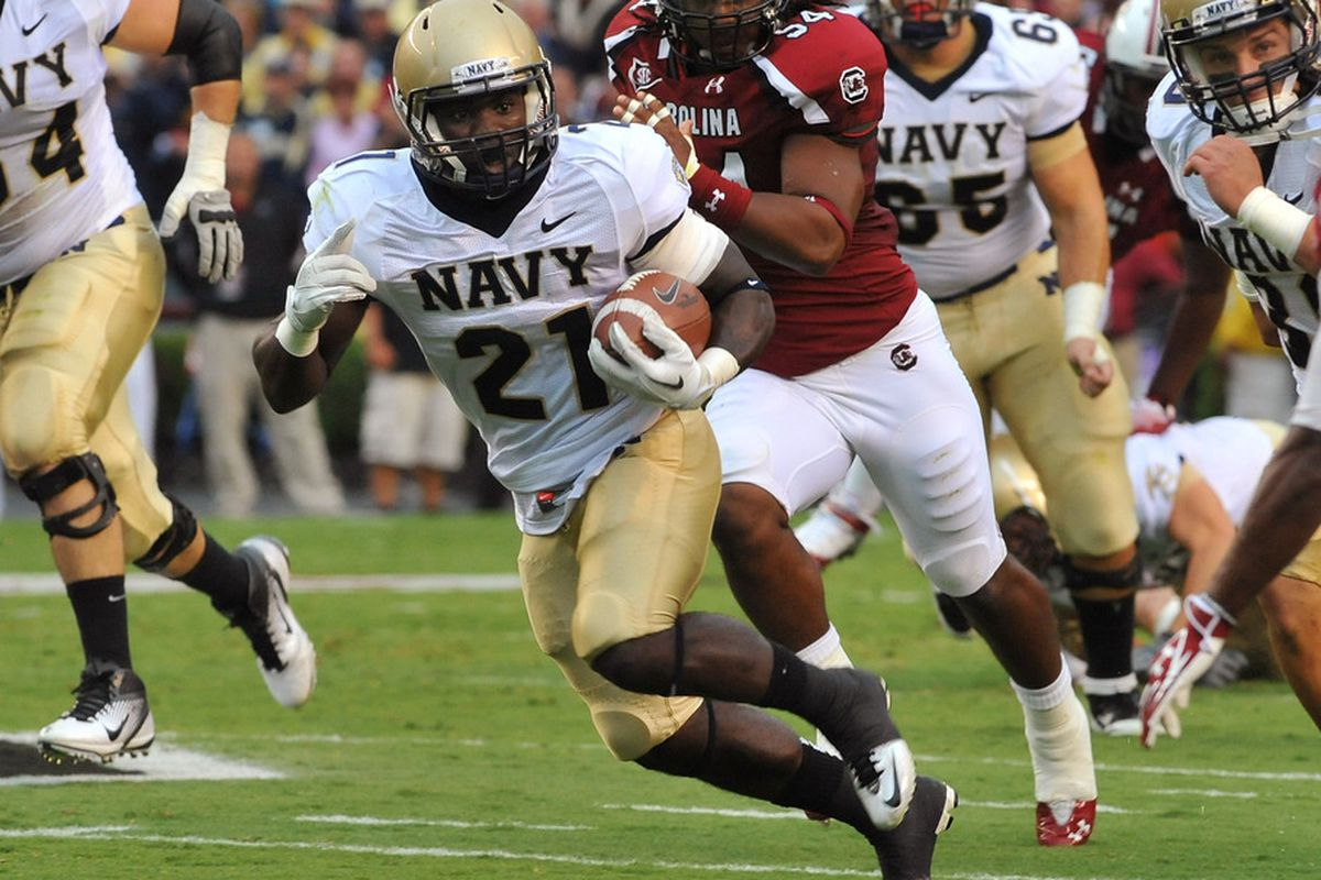 COLUMBIA, SC - SEPTEMBER 17:  Running back Gee Gee Greene #21 of Navy Midshipment rushes upfield against the South Carolina Gamecocks September 17, 2011 at Williams-Brice Stadium in Columbia, South Carolina.  (Photo by Al Messerschmidt/Getty Images)