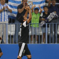 Malaga's Javier Saviola from Argentina, reacts after scoring a goal against Zenit St Petersburg during the group C Champions League soccer match at the Rosaleda stadium in Malaga, Spain, Tuesday, Sept. 18, 2012.