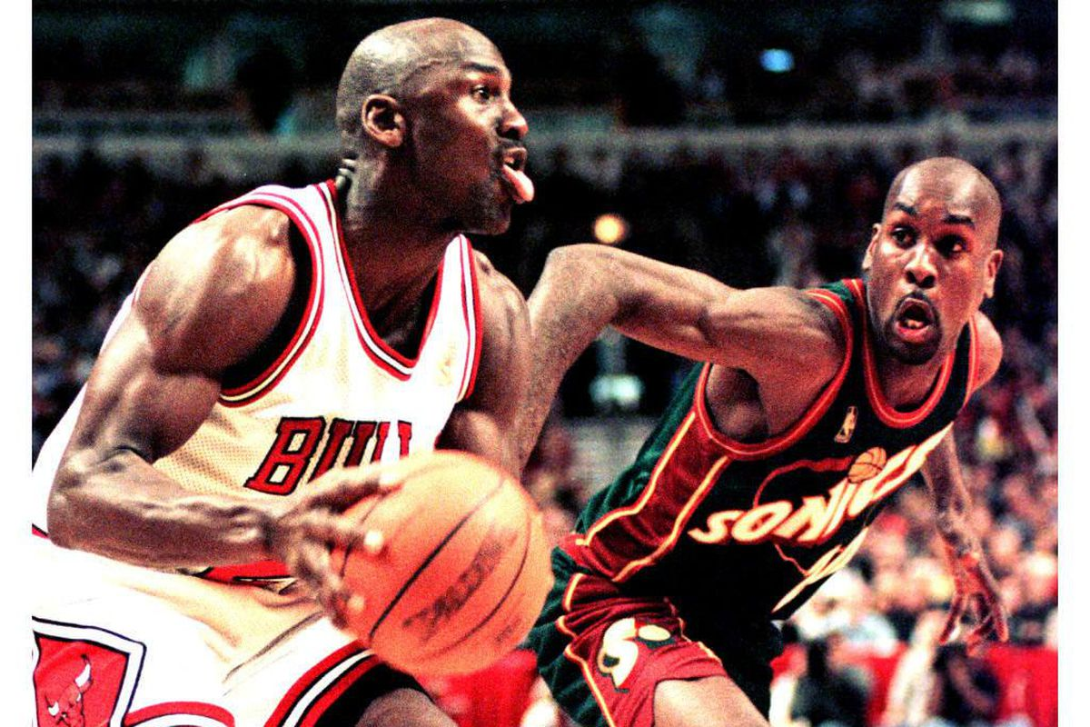 Michael Jordan of the Chicago Bulls looks to make a basket as Seattle SuperSonics guard Gary Payton defends in the fourth quarter of the 18 March game at the United Center in Chicago, Illinois. The Bulls defeated the Supersonics 89-87 in overtime.