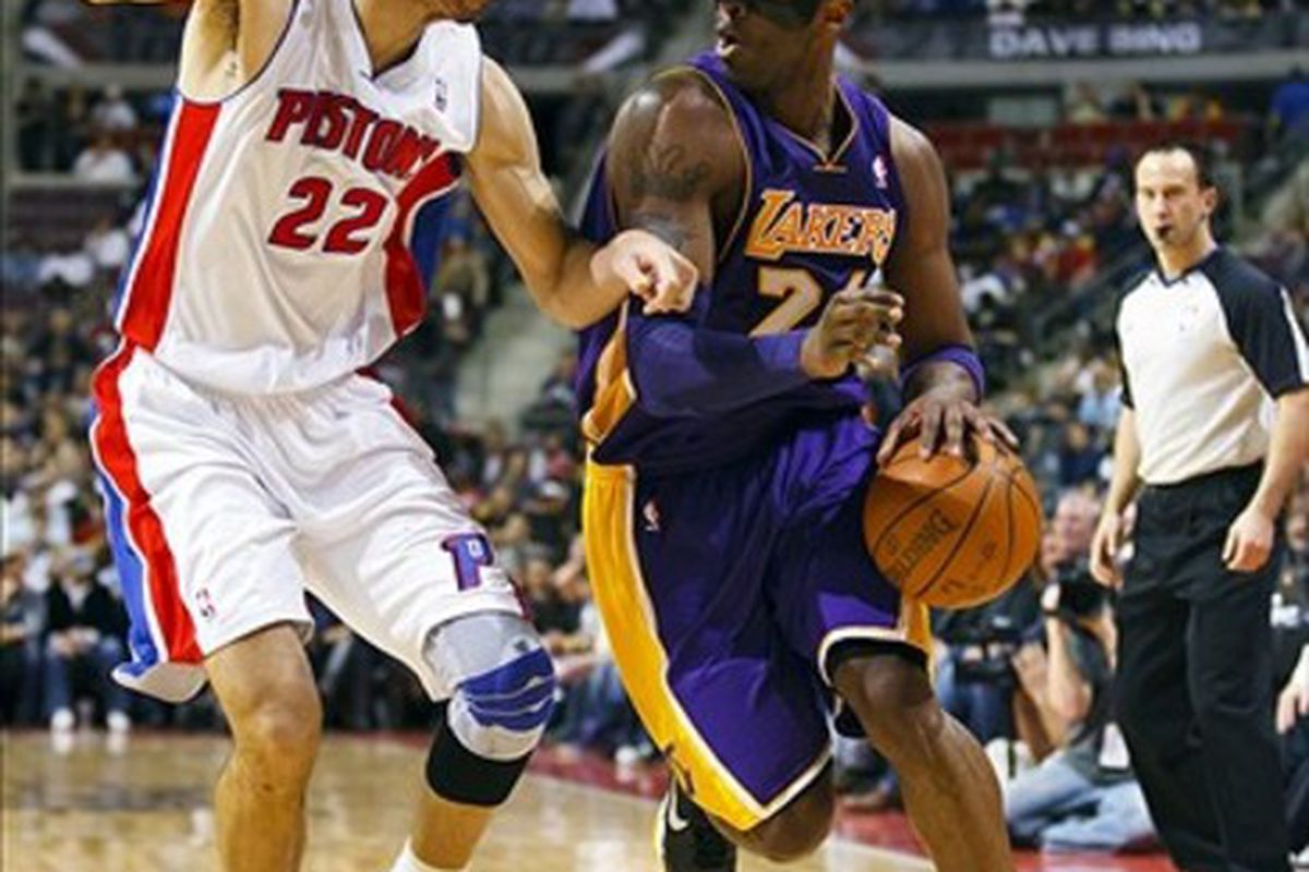 March 6, 2012; Auburn Hills, MI, USA; Los Angeles Lakers shooting guard Kobe Bryant (24) moves the ball on Detroit Pistons small forward Tayshaun Prince (22) in the first quarter at The Palace. Mandatory Credit: Rick Osentoski-US PRESSWIRE