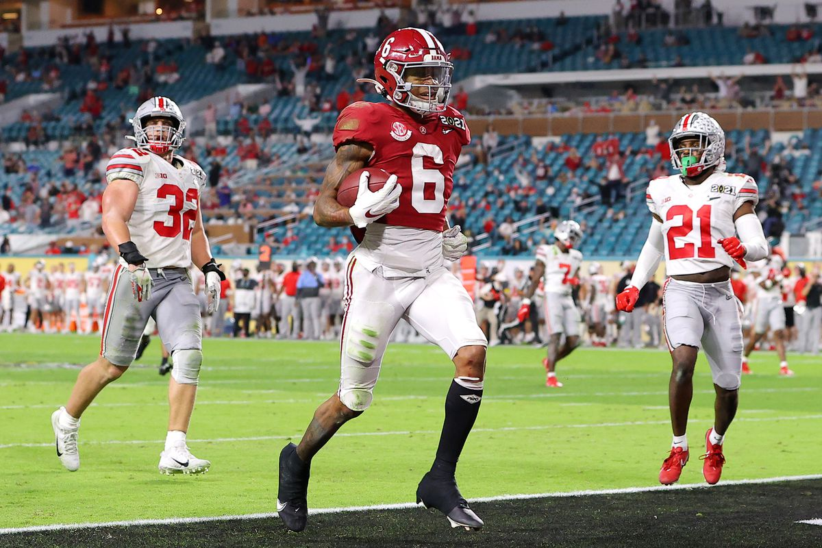 DeVonta Smith of the Alabama Crimson Tide rushes for a 42-yard touchdown during the second quarter of the College Football Playoff National Championship game against the Ohio State Buckeyes at Hard Rock Stadium on January 11, 2021 in Miami Gardens, Florida.