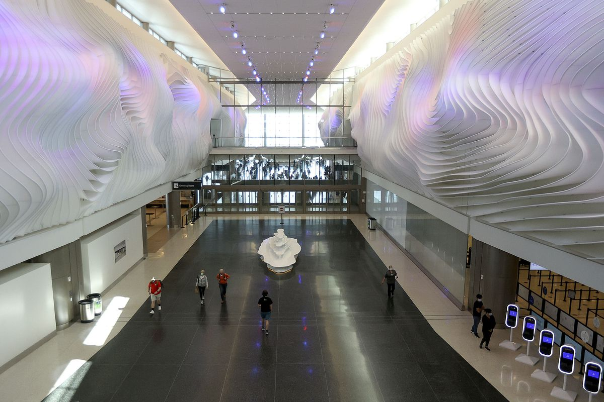 """Gordon Huether's """"The Canyon"""" artwork featured along the walls of the Salt Lake City International Airport."""