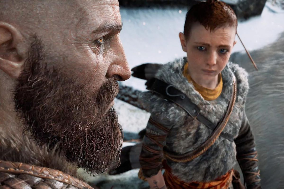 God of War - Kratos looks into the distance as Atreus looks up at him
