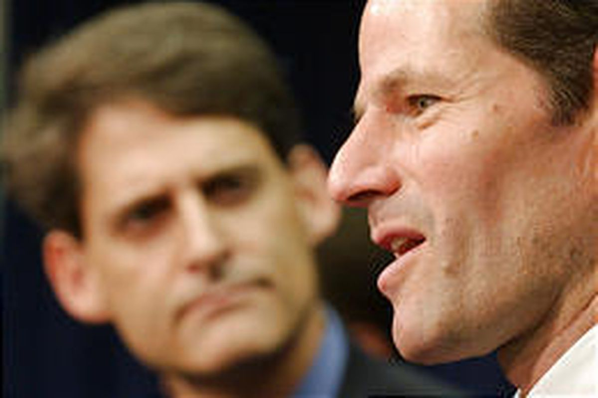 New York Attorney General Eliot Spitzer, right, and SEC official Stephen M. Cutler announce charges against ex-Bank of America broker Theodore Sihpol III.