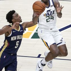 Utah Jazz center Marques Bolden (24) passes the ball in front of New Orleans Pelicans forward Herbert Jones (5) during a preseason NBA game at the Vivint Smart Home Arena in Salt Lake City on Monday, Oct. 11, 2021. The Jazz won 127-96.
