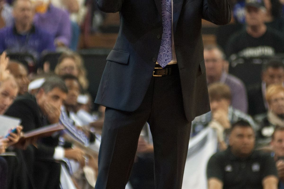 Coach Malone drinks from an invisible jug of wine.