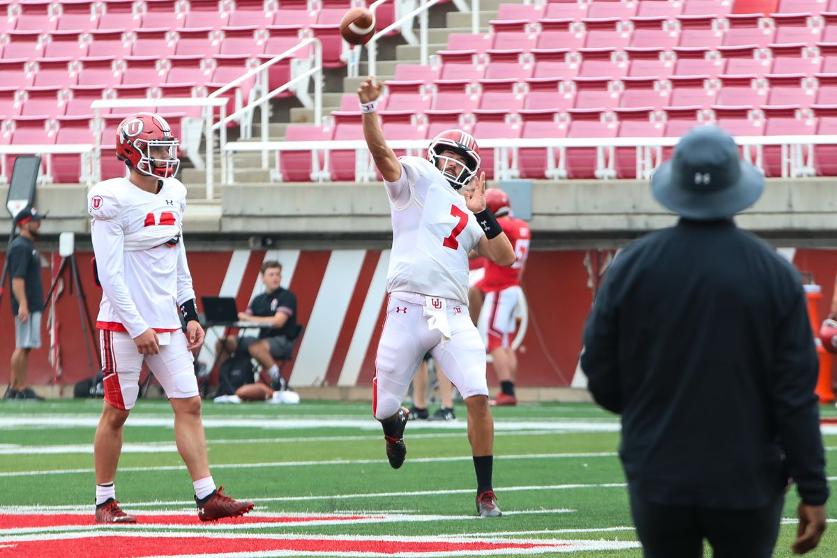 Baylor transfer Charlie Brewer, left, looks on as Cam Rising makes a throw during practice at Rice-Eccles Stadium.