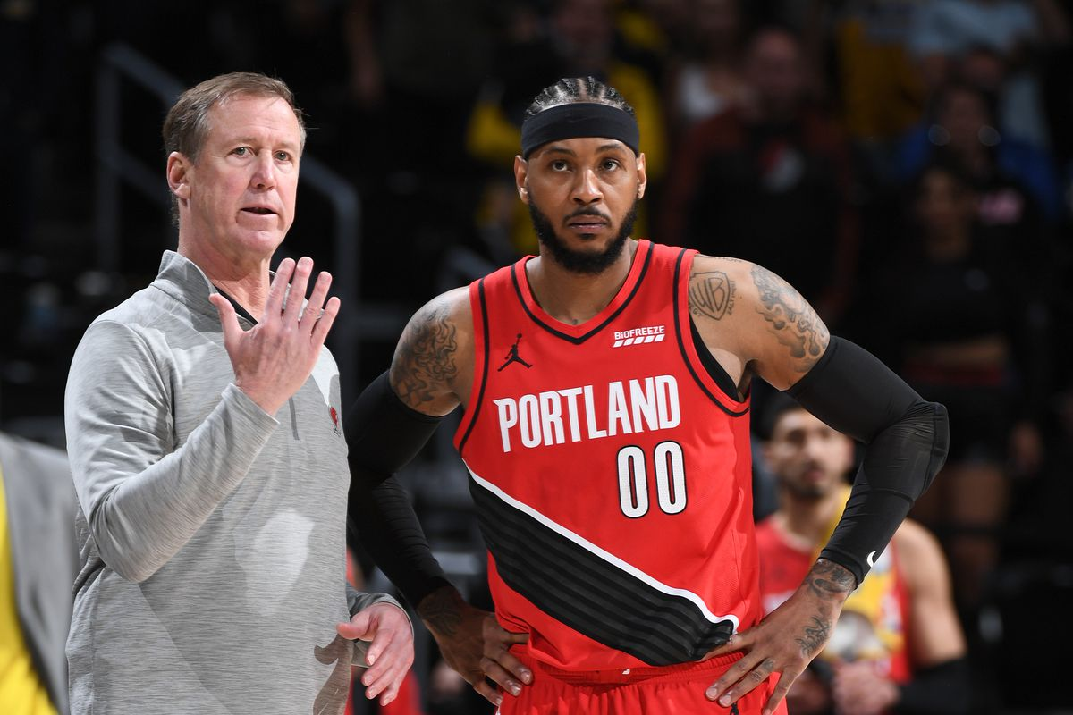 Head Coach, Terry Stotts talks with Carmelo Anthony #00 of the Portland Trail Blazers during the game against the Denver Nuggets during Round 1, Game 5 of the 2021 NBA Playoffs on June 1, 2021 at the Ball Arena in Denver, Colorado.