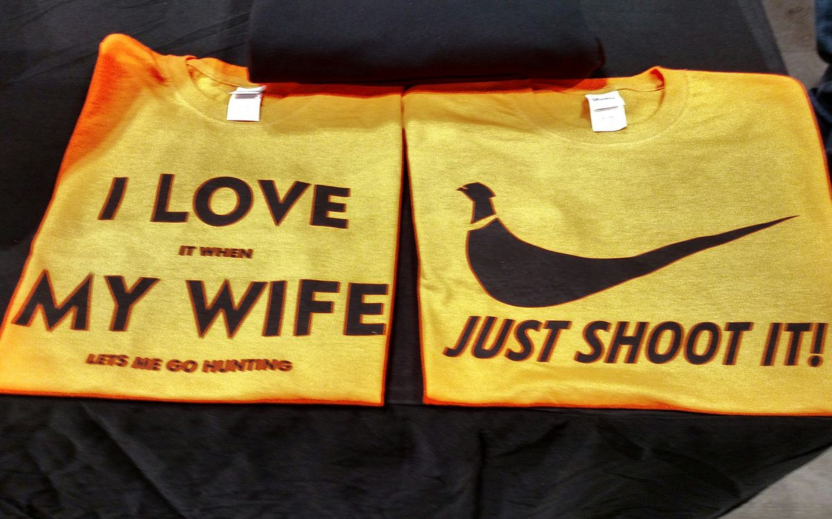 Wear with pithy sayings at the DeBoer's Guiding Service booth next to the Sun-Times booth.<br>Dale Bowman/Sun-Times