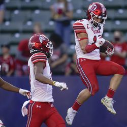 Utah wide receiver Britain Covey (18) celebrates after scoring a touchdown during the first half of an NCAA college football game against San Diego State Saturday, Sept. 18, 2021, in Carson, Calif.