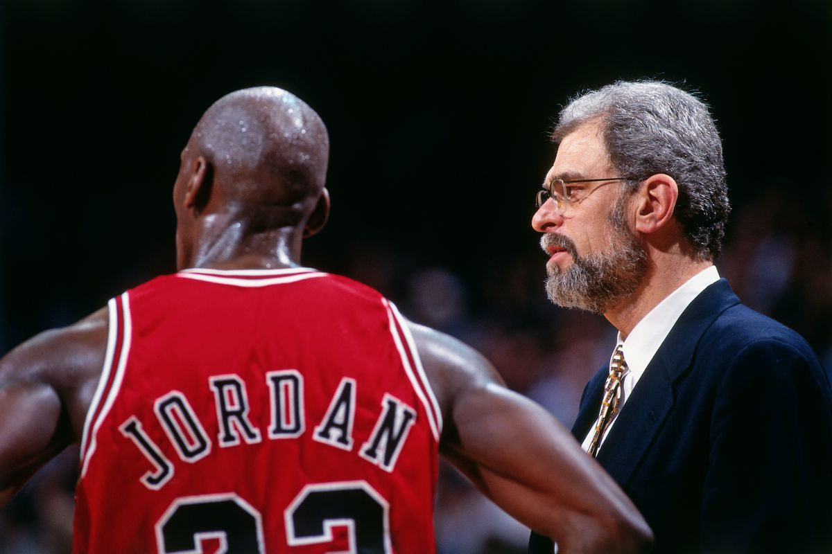 MIAMI - APRIL 2: Michael Jordan #23 and Phil Jackson of the Chicago Bulls look on against the Miami Heat on April 2, 1996 at Miami Arena in Miami, Florida. NOTE TO USER: User expressly acknowledges and agrees that, by downloading and or using this photograph, User is consenting to the terms and conditions of the Getty Images License Agreement. Mandatory Copyright Notice: Copyright 1996 NBAE (Photo by Andrew D. Bernstein/NBAE via Getty Images)