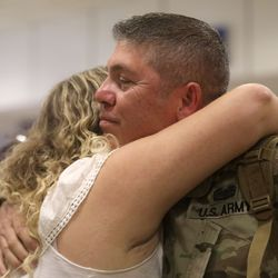 Sgt. Major Raymond Loy hugs his daughter Brooke Loy at the Salt Lake International Airport in Salt Lake City on Tuesday, Aug. 27, 2019, as he and other members of the Utah National Guard's 4th Infantry Division Main Command Post Operational Detachment return home after serving in Afghanistan for 10 months in support of Operation Freedom's Sentinel.