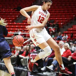 Utah Utes forward Emily Potter (12) leaps out of bounds attempting to save the possession as Utah hosts Saint Mary's at the Huntsman Center in Salt Lake on Saturday, Dec. 2, 2017.