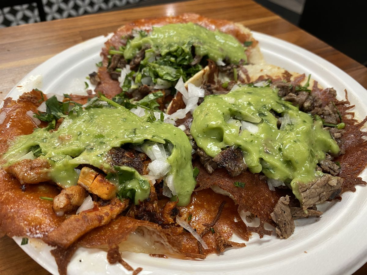 A plate of Tijuana-style quesatacos