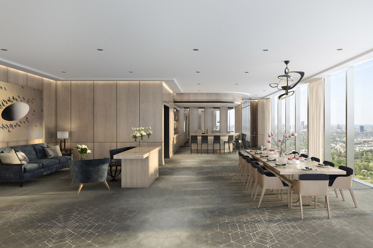 A rendering of the unit with tall ceilings, windows with views of the Atlanta skyline.
