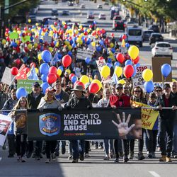 Hundreds march north along State Street from the Salt Lake City-County Building to the state Capitol during the March to End Child Abuse, organized by Protect Every Child, in Salt Lake City on Saturday, Oct. 5, 2019. The marchers carried red, yellow and blue balloons which match the logo of Protect Every Child.