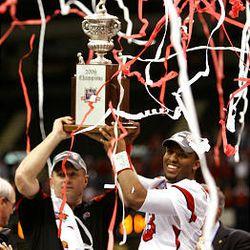 Utah coach Kyle Whittingham and QB Brian Johnson celebrate 2009 Sugar Bowl win over Alabama.