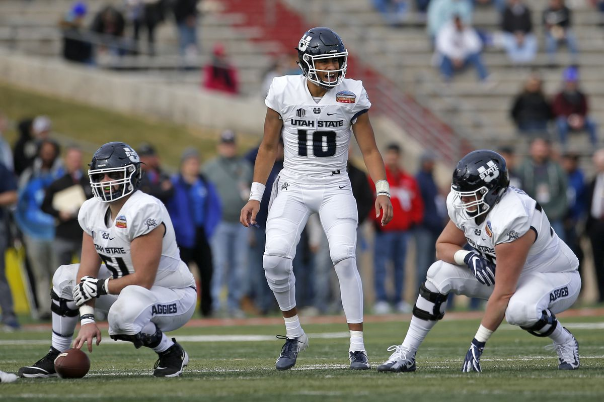 Utah State quarterback Jordan Love (10) yells prior to the snap as center Quin Ficklin (51) and offensive lineman Roman Andrus (76) looks on during the first half of the New Mexico Bowl NCAA college football game against North Texas in Albuquerque, N.M.,