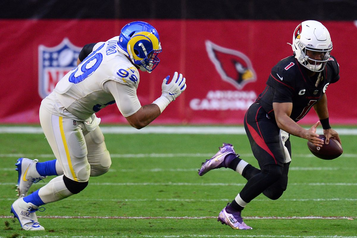 Los Angeles Rams defensive end Aaron Donald (99) chases down Arizona Cardinals quarterback Kyler Murray (1) during the first half at State Farm Stadium.