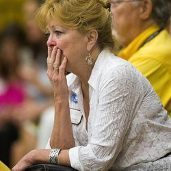 Lana Pomel, whose friend's son was a member of the Granite Mountain Hot Shot crew,  cries listening to a press conference at Prescott High School, Monday, July 1, 2013 talking about the tragedy that took the lives of 19 members of the Granite Mountain Hot Shot crew, Sunday.  (AP Photo/The Arizona Republic, Tom Tingle)
