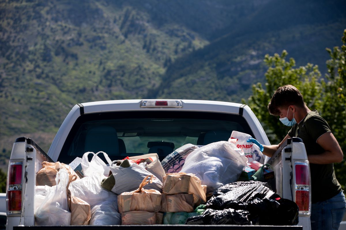 """Joshua Petersen loads donations into a truck for the Ogden Rescue Mission and the Lantern House outside Kirt's Family Drive Inn in Ogden on Monday, May 25, 2020. """"I've been surprised, many people said 'thanks for giving us the opportunity to help, we just didn't know how,'"""" Grant Protzman said. """"There's a real need."""""""