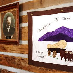 Items on the walls of Santaquin cabin depict Utah history. The Daughters of the Utah Pioneers recently refurbished the cabin, and members are collecting items of period age to include in the museum.