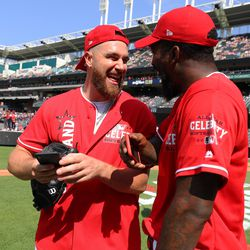 Travis Kelce of the Kansas City Chiefs and J.R. Smith of the Cleveland Cavaliers joke prior to the Legends & Celebrity Softball Game at Progressive Field on Sunday, July 7, 2019 in Cleveland, Ohio.