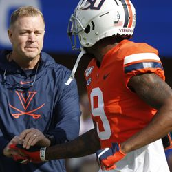 Virginia head coach Bronco Mendenhall shakes the hand of Virginia wide receiver Terrell Chatman (9) before an NCAA college football game against Duke in Charlottesville, Va., Saturday, Oct. 19, 2019.