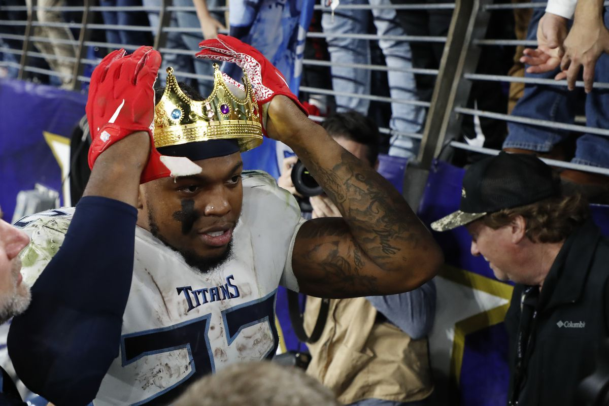 Tennessee Titans running back Derrick Henry celebrates with fans after the Titans game against the Baltimore Ravens in a AFC Divisional Round playoff football game at M&T Bank Stadium.