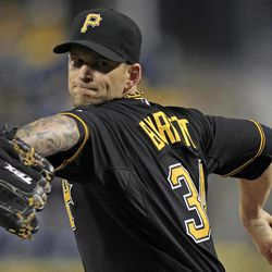Pittsburgh Pirates starting pitcher A.J. Burnett (34) delivers during the first inning of a baseball game against the Cincinnati Reds in Pittsburgh Friday, Sept. 28, 2012.