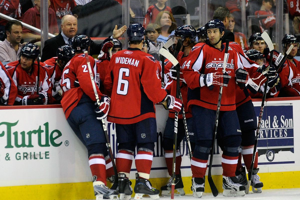 WASHINGTON, DC - SEPTEMBER 30:  Head coach Bruce Boudreau of the Washington Capitals talks to his team during a timeout against the Buffalo Sabres at the Verizon Center on September 30, 2011 in Washington, DC.  (Photo by Greg Fiume/Getty Images)