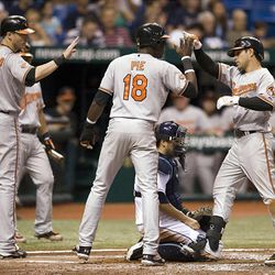 Baltimore Orioles' Nolan Reimold (14), Felix Pie (18) and Brian Roberts, right, celebrate Robert's' grand slam off Tampa Bay reliever Lance Cormier.